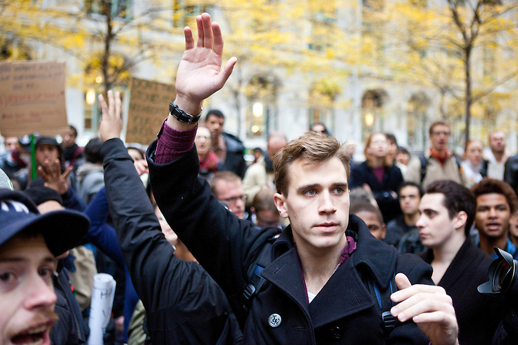 """After marching earlier in the morning with the aim to shut down Wall Street and the Stock Exchange, hundreds of protesters regather in Zuccotti Park to determine their next move on November 17, 2011 in New York City.  The action was the first in a day of protests celebrating the two month anniversary of the """"Occupy Wall Street"""" movement.  While many workers were inconvenienced by the human (and police) barricades, the Stock Exchange opened on schedule."""