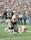 Washington Redskins running back John Riggins (44) follows a block by tight end Don Warren (85) in game action against the Los Angeles Raiders at RFK Stadium in Washington, D.C. on October 2, 1983.  Raiders right inside linebacker Bob Nelson (51) is in pursuit of Riggins.  The Redskins won the game 37 - 35.<br /> Credit: Howard L. Sachs / CNP