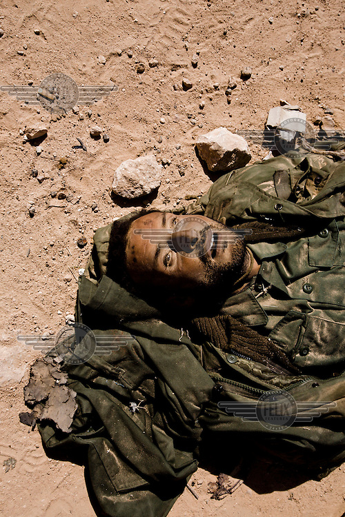 A dead Gaddafi loyalist soldier lies on the side of the road on the eastern outskirts of Ajdabiya after a Nato air strike. On 17 February 2011 Libya saw the beginnings of a revolution against the 41 year regime of Col Muammar Gaddafi.