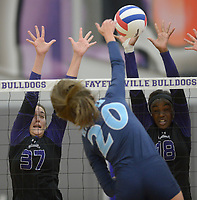 NWA Democrat-Gazette/ANDY SHUPE<br /> Har-Ber's Lauren Thompson (20) sends the ball over the net as Fayetteville's Carly Unruh (37) and Arianna Walter (18) defend Wednesday, Sept. 13, 2017, during play in Bulldog Arena. Visit nwadg.com/photos to see more photographs from the match.