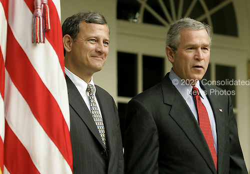 Washington, D.C. - July 20, 2005 -- United States President George W. Bush stands with Supreme Court nominee, John G. Roberts Jr. while speaking to reporters at the White House in Washington, D.C. on July 20, 2005.  If confirmed by the United States Senate,  Roberts would fill the vacancy created by Justice Sandra Day O'Conner who announced her retirement last month..Credit: Mark Wilson - Pool via CNP