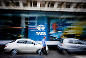A man walks past the branding of TATA group of companies outside the TATA House in Mumbai.