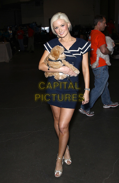 "HOLLY MADISON.The Animal Foundations 8th Annual ""Best In Show"" at The Orleans Arena Las Vegas, Las Vegas, Nevada, USA..May 1st, 2011.full length blue navy dress white trim stripe carrying dog animal pet nautical .CAP/ADM/MJT.© MJT/AdMedia/Capital Pictures."