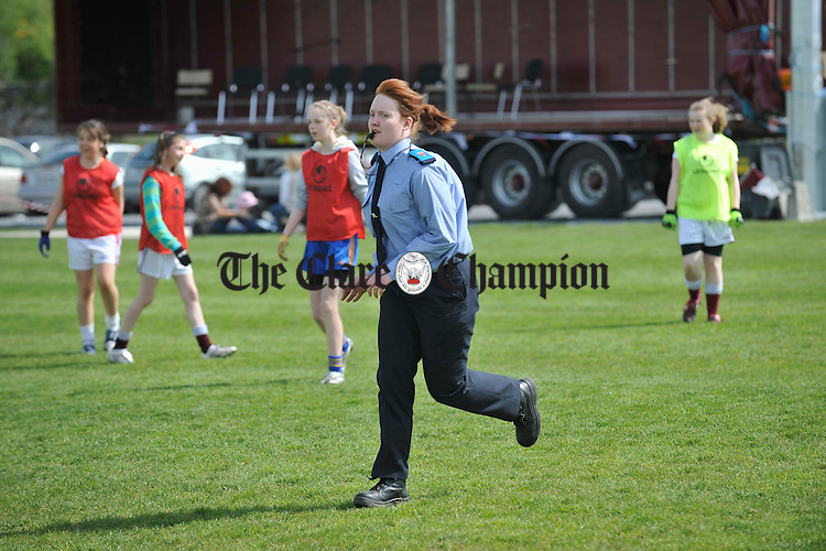 Student Garda Catherine Anderson refereeing a game during the St Joseph's GAA 125th anniversary celebrations at Gurteen. Photograph by John Kelly.