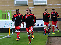 MK Dons players enter the field of play for the pre-match warm up during Forest Green Rovers vs MK Dons, Caraboa Cup Football at The New Lawn on 8th August 2017