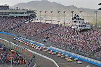 Nov. 9, 2008; Avondale, AZ, USA; NASCAR Sprint Cup Series drivers head into turn one on the first lap of the Checker Auto Parts 500 at Phoenix International Raceway. Mandatory Credit: Mark J. Rebilas-