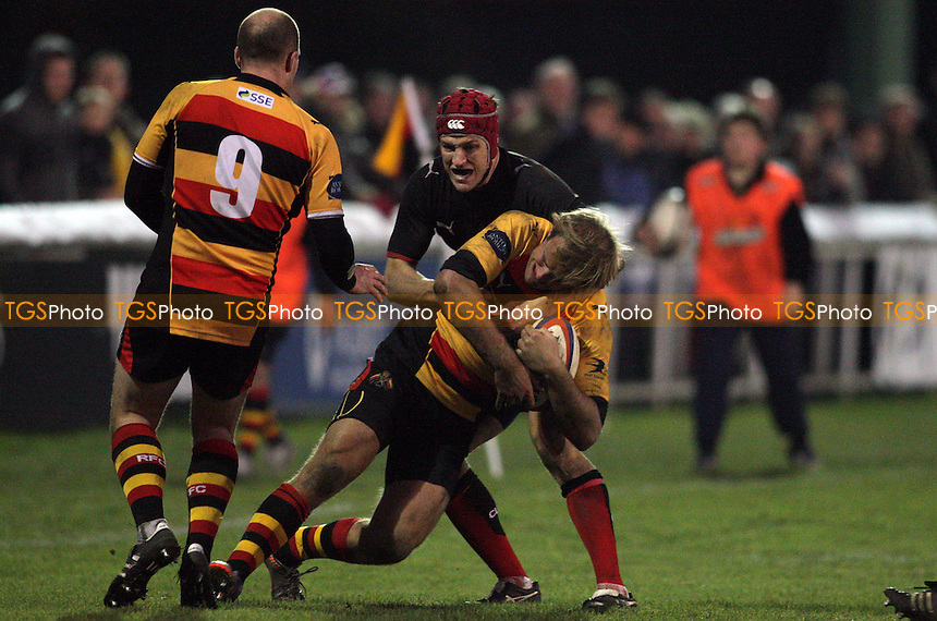 Richmond's James Greenwood is tackled by Blackheath's Richard Windsor -  Richmond RFC vs Blackheath RFC - SSE National League One Rugby at The Athletic Ground, Richmond, London - 08/12/12 - MANDATORY CREDIT: Helen Watson/TGSPHOTO - Self billing applies where appropriate - 0845 094 6026 - contact@tgsphoto.co.uk - NO UNPAID USE.