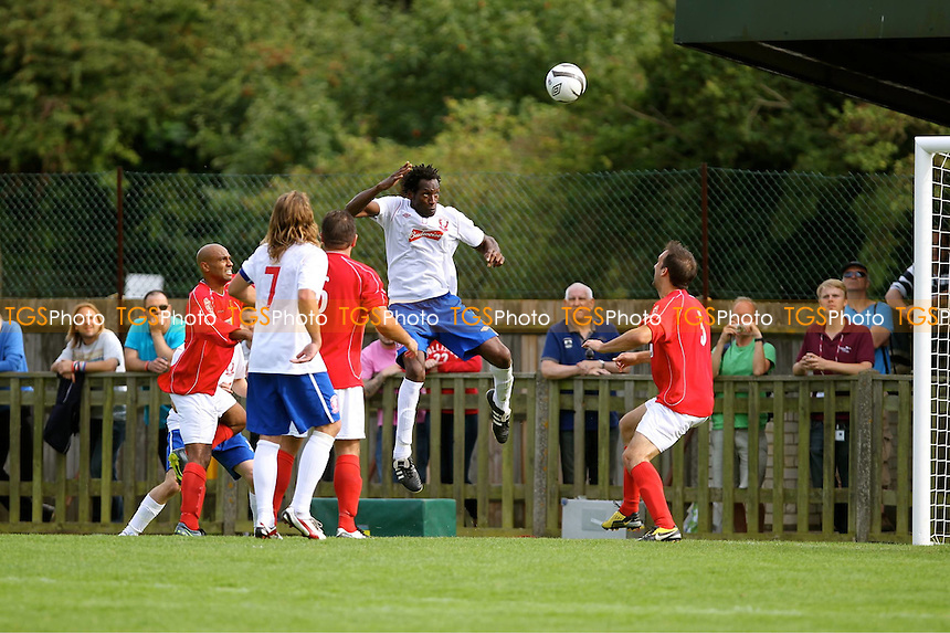 Ugo Ehiogu of Wembley rises highest to win the ball  - Uxbridge vs Wembley - FA Cup Preliminary Round Football at Honeycroft, Uxbridge, Middlesex - 26/08/12 - MANDATORY CREDIT: Andy Nunn/TGSPHOTO - Self billing applies where appropriate - 0845 094 6026 - contact@tgsphoto.co.uk - NO UNPAID USE.