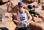 August 15, 2015 - Manitou Springs, Colorado, U.S. - Arvada, Colorado runner, Kyle O'Brien, waves to the crowd as he completes the Pikes Peak Ascent during the 60th running of the Pikes Peak Ascent and Marathon.  During the Ascent, runners cover 13.3 miles and gain more than 7815 feet (2382m) by the time they reach the 14,115ft (4302m) summit.  On the second day of race weekend, 800 marathoners will make the round trip and cover 26.6 miles of high altitude and very difficult terrain in Pike National Forest, Manitou Springs, CO.