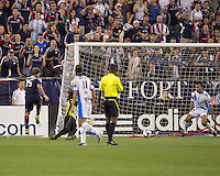 Puebla FC defender Juan Garcia (18) on the goal line prevents a goal after New England Revolution forward Zack Schilawski (15) shot eludes Puebla FC goalkeeper Edgar Hernandez (1). The New England Revolution defeated Puebla FC in penalty kicks, in SuperLiga 2010 semifinal at Gillette Stadium on August 4, 2010.