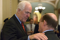 United States Senate Majority Whip John Cornyn (Republican of Texas) speaks with US Senator Chris Coons (Democrat of Delaware) outside the US Senate chamber in the US Capitol in Washington, DC on Friday, December 1, 2017. Photo Credit: Alex Edelman/CNP/AdMedia