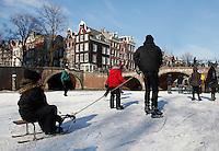 Sleeen op de grachten in Amsterdam