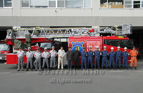 Nov. 15, 2011; Minamisanriku, Miyagi Pref., JPN - Aid to Tohoku, Japan. ..San Francisco Fire Department Station 15 raised money to help their fellow firefighters in Japan. When we asked to take a photo with the Kesennuma Motoyoshi Fire Department, they didn't mess around, they pulled out their biggest fire truck to pose with!..They said the money will be used in honor of the 6 firefighters who were lost as a result of the tsunami.