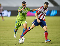 CARSON, CA - August 25, 2012: Seattle forward Sammy Ochoa (26) and Chivas USA defender Bobby Burling (2) during the Chivas USA vs Seattle Sounders match at the Home Depot Center in Carson, California. Final score, Chivas USA 2, Seattle Sounders 6.