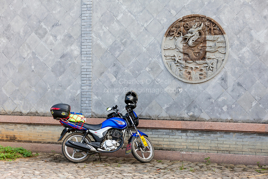Cangpo, Zhejiang, China.  Motorcycle, Dragon Decoration on Wall.