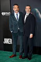 "LOS ANGELES, USA. September 29, 2019: Todd Phillips & Joaquin Phoenix at the premiere of ""Joker"" at the TCL Chinese Theatre, Hollywood.<br /> Picture: Paul Smith/Featureflash"