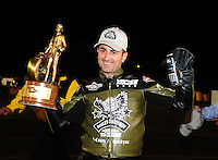Nov 14, 2010; Pomona, CA, USA; NHRA pro stock motorcycle rider Eddie Krawiec celebrates after winning the Auto Club Finals at Auto Club Raceway at Pomona. Mandatory Credit: Mark J. Rebilas-