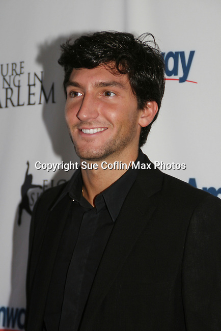 Olympic skater Evan Lysacek at the 2009 Skating with the Stars - a benefit gala for Figure Skating in Harlem on April 6, 2009 at Wollman Rink, Central Park, NYC, NY. (Photo by  Sue Coflin/Max Photos)