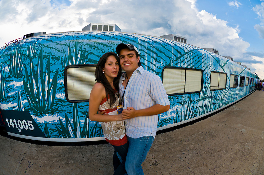 A Mexican couple dances before the departure of the Tequila Express train (back to Guadalajara) at the train station in the town of Tequila, Mexico