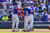 Chicago Cubs catcher Miguel Montero (47) is greeted at home by Chris Coghlan (8) and Ben Zobrist (18) after hitting a home run during a game against the Atlanta Braves at Turner Field on June 11, 2016 in Atlanta, Georgia. The Cubs defeated the Braves 8-2. (Tony Farlow/Four Seam Images)