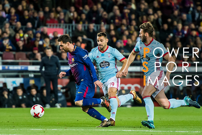 Lionel Andres Messi (L) of FC Barcelona is followed by Jonathan Castro Otto, Jonny (C) and Sergi Gomez Sola of RC Celta de Vigo during the Copa Del Rey 2017-18 Round of 16 (2nd leg) match between FC Barcelona and RC Celta de Vigo at Camp Nou on 11 January 2018 in Barcelona, Spain. Photo by Vicens Gimenez / Power Sport Images