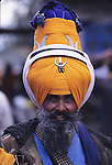 For the past 300 years the Nihangs, Holy warriors of Sikhism gather at the foothills of the Himalayas in Punjab to celebrate the Hola Mohalla,  the creation of the Sikh Army by Guru Gobind Singh to defend the Sikh homeland from the invading Mughal armies. Dressed in their traditional blue colors, they arrive barring their weapons  in Anandpur Sahib, demonstrating their prowess in martial arts and horse riding. Duels take place everywhere, while others prepare the 'Nectar', a cannabis-laced drink that they distribute freely. The 'Pharhara' the tall turban worn by the Nihang distinguish the leaders and warlords. Such a high headwear was like a flag on the battefield, allowing the warior to use both hands while leading the soldiers. India, Punjab. (Photo by Jean-Marc Giboux)