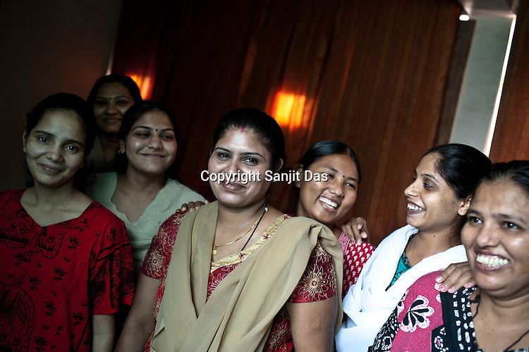 31 year old Rubina Mondal (centre) poses for a photograph with the first time surrogate mothers she is mentoring at her home in Anand, Gujarat, India.