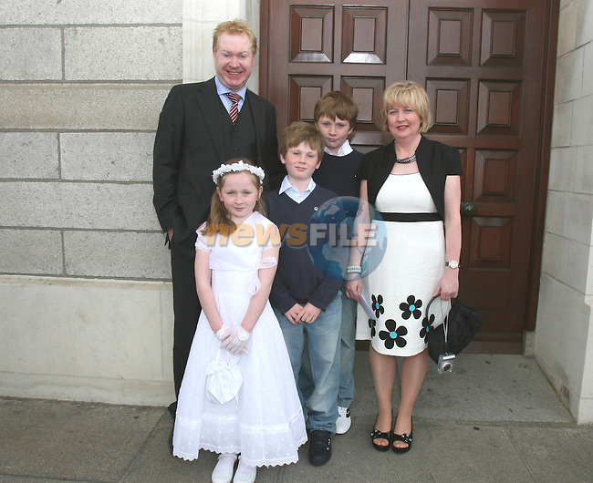 Des, Rhona, Rory, Killian and Alison Grant at St Brigid's NS Communion in the Lourdes Church....Photo NEWSFILE/Jenny Matthews.(Photo credit should read Jenny Matthews/NEWSFILE)....This Picture has been sent you under the condtions enclosed by:.Newsfile Ltd..The Studio,.Millmount Abbey,.Drogheda,.Co Meath..Ireland..Tel: +353(0)41-9871240.Fax: +353(0)41-9871260.GSM: +353(0)86-2500958.email: pictures@newsfile.ie.www.newsfile.ie.FTP: 193.120.102.198.