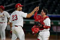 Palm Beach Cardinals relief pitcher Junior Fernandez (23) and catcher Alexis Wilson (26) high five after closing out a Florida State League game against the Daytona Tortugas on April 11, 2019 at Roger Dean Stadium in Jupiter, Florida.  Palm Beach defeated Daytona 6-0.  (Mike Janes/Four Seam Images)