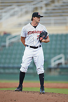 Kannapolis Intimidators relief pitcher William Kincanon (29) looks to his catcher for the sign against the West Virginia Power at Kannapolis Intimidators Stadium on July 25, 2018 in Kannapolis, North Carolina. The Intimidators defeated the Power 6-2 in 8 innings in game one of a double-header. (Brian Westerholt/Four Seam Images)