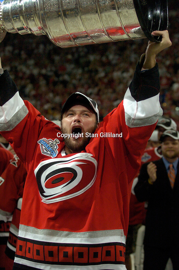 Oleg Tverdovsky of Russia holds the Stanley Cup after the Carolina Hurricanes beat the Edmonton Oilers 3-1 in game seven to win the series at the RBC Center in Raleigh, NC Monday, June 19, 2006.