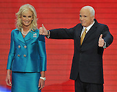 "St. Paul, MN - September 4, 2008 -- United States Senator John McCain (Republican of Arizona) flashes a ""thumbs-up"" to his supporters after accepting his party's nomination as President of the United States on day 4 of the 2008 Republican National Convention at the Xcel Energy Center in St. Paul, Minnesota on Thursday, September 4, 2008.  His wife, Cindy McCain  looks on from the left..Credit: Ron Sachs / CNP"