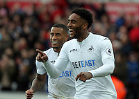 (L-R) Luciano Narsingh and team mate Leroy Fer of Swansea City celebrate the first goal scored by their team during the Premier League match between Swansea City and Burnley at The Liberty Stadium, Swansea, Wales, UK. Saturday 04 March 2017