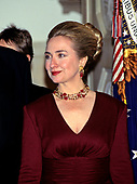 First lady Hillary Rodham Clinton stands at the Grand Staircase of the White House in Washington, DC as she and United States President Bill Clinton welcome Chancellor Helmut Kohl of Germany for an Official Dinner on Thursday, February 9, 1995.<br /> Credit: John Harrington / Pool via CNP