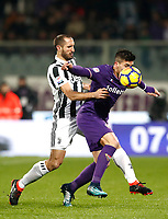 Calcio, Serie A: Fiorentina - Juventus, stadio Artemio Franchi Firenze 9 febbraio 2018.<br /> Fiorentina's Giovanni Simeone (r) in action with Juventus' Giorgio Chiellini (l)during the Italian Serie A football match between Fiorentina and Juventus at Florence's Artemio Franchi stadium, February 9, 2018.<br /> UPDATE IMAGES PRESS/Isabella Bonotto