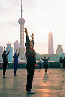 Early morning exercisers at Huangpu Park (Pudong in background), Shanghai, China