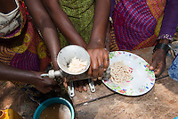 Africa, DRC, Democratic Republic of the Congo, South Kivu, Kamanyola. Women for Women project. WFW Kamanyala co-op and lifeskills training. Come 2x a week, 2 hours a day for 1 year. Women making soy milk & cassava  products such as cheese, bread and fried snacks.