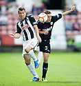 Dunfermline's Paul Willis and Partick's Stuart Bannigan challenge for the ball.