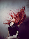 Young redhead woman flinging her hair