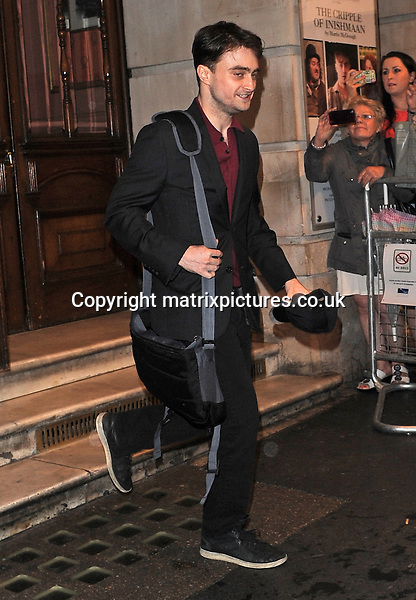 NON EXCLUSIVE PICTURE: PALACE LEE / MATRIXPICTURES.CO.UK<br /> PLEASE CREDIT ALL USES<br /> <br /> WORLD RIGHTS<br /> <br /> English actor Daniel Radcliffe is pictured leaving London's Noel Coward Theatre, following a lead performance in The Cripple Of The Inishmaan.<br /> <br /> AUGUST 24th 2013<br /> <br /> REF: LTN 135672