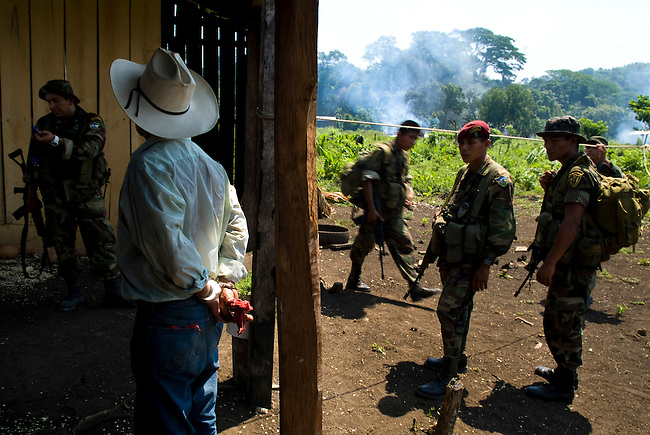The Guatemalan military evict a family from an illegal store inside the Mayan Biosphere. Most evictions target poor people working for rich land owners who return within months of the evictions.