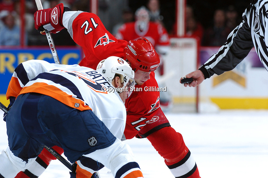 New York Islanders' Shawn Bates faces off with Carolina Hurricanes' Eric Staal during their game Thursday, Jan. 19, 2006 in Raleigh, NC. Carolina won 4-3.