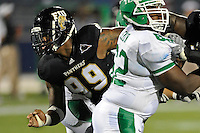 1 September 2011:  FIU defensive line Isame Faciane (99) breaks through the line in the second half as the FIU Golden Panthers defeated the University of North Texas, 41-16, at FIU Stadium in Miami, Florida.