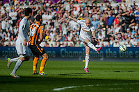 SWANSEA, WALES - APRIL 04: Jonjo Shelvey of Swansea City  takes a shot at goal during the Premier League match between Swansea City and Hull City at Liberty Stadium on April 04, 2015 in Swansea, Wales.  (photo by Athena Pictures)