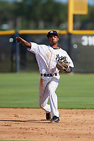 New York Yankees shortstop Jose Devers (4) throws to first base during an Instructional League game against the Baltimore Orioles on September 23, 2017 at the Yankees Minor League Complex in Tampa, Florida.  (Mike Janes/Four Seam Images)