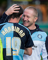 Wycombe Assistant Manager Richard Dobson hugs double goalscorer Michael Harriman of Wycombe during the Sky Bet League 2 match between Wycombe Wanderers and Hartlepool United at Adams Park, High Wycombe, England on 5 September 2015. Photo by Andy Rowland.