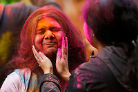 EXCHANGE PLACE, NJ - MAY 7 : Women play with colored powder while people take part during Holy hai celebrations on May 7, 2016 in Exchange Place, New Jersey. Thousands of people of all ages attend Holi hai festivities also known as the festival of colors or the festival of sharing love, by Indian culture.  Photo by VIEWpress