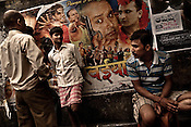 young men gather outside a video hall showing Bollywood films in Dharavi, Mumbai, India