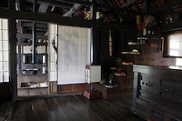 The kitchen is in the traditional Japanese style wih a mizuya-tansu (kitchen chest) and kaidan-tansu (stairchest) with room for pots and trays