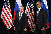President Vladimir Putin of Russia and United States President Barack Obama pose for photographs before the start of a bilateral meeting at the United Nations headquarters September 28, 2015 in New York City. Putin and Obama are in New York City to attend the 70th anniversary general assembly meetings.<br /> Credit: Chip Somodevilla / Pool via CNP